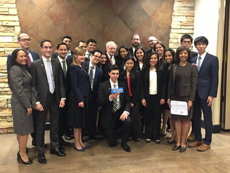 Baruch College students pose with Warren Buffet
