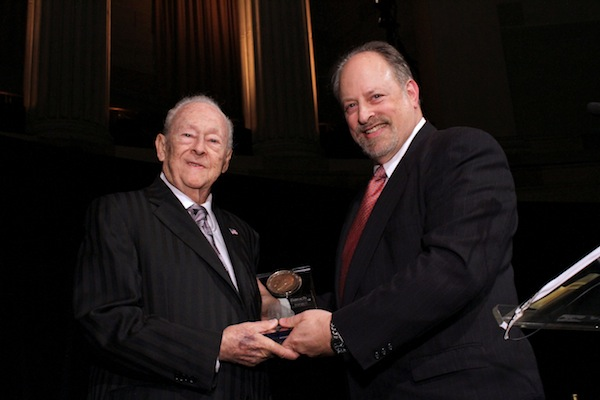 Baruch President Mitchel B. Wallerstein (at right) presents the President?s Medal to 2012 Honoree William M. Newman ?47, Hon., LLD ?97.