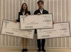 Baruch College students Xinyi Liu (left) and Cheng Ni (right) display their monetary wins from the annual Traders@MIT Fall Intercollegiate Competition