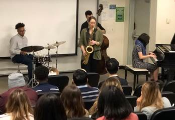 Students in Baruch College's Global Cultural Exchange Certificate Program listen to a Jazz performance to learn about American cultural activities.