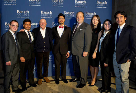 Ron Perelman and President Wallerstein pose with students