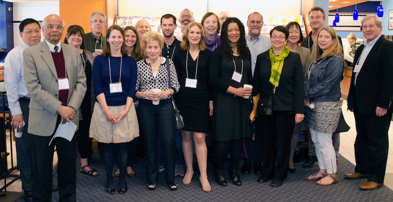 A bevy of Baruch authors at the Baruch Bookstore reception, in front of the display case selling their books.